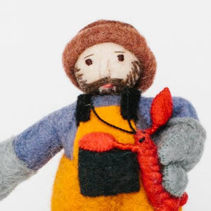A Craftspring handmade felt lobsterman ornament holding a small red lobster and wearing orange overalls