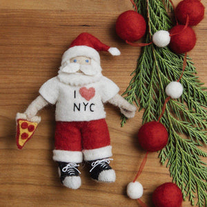 A Craftspring handmade felt santa ornament wearing a I love New York t-shirt, converse and holding a slice of pizza
