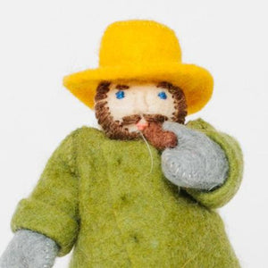 A Craftspring handmade felt old fisherman ornament smoking a pipe and wearing a green coat and yellow hat holding a small fish