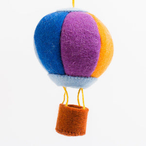 A Craftspring handmade felt rainbow hot air balloon ornament