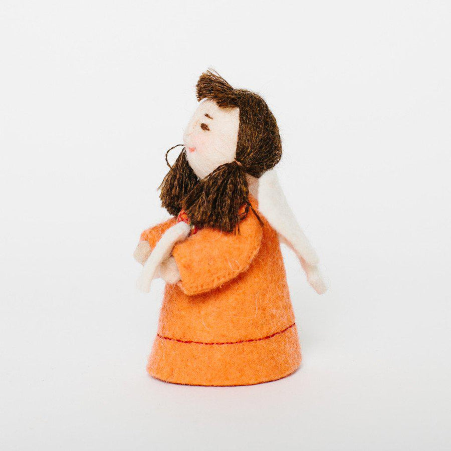 A Craftspring handmade felt fairy ornament with white wings an orange dress and brown hair in pigtails holding a small white butterfly