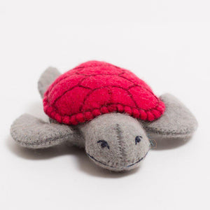 A Craftspring handmade felt turtle ornament with a red shell