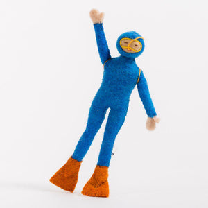 A craftspring handmade felt scuba diver ornament wearing a blue wetsuit orange flippers and a yellow diving tank
