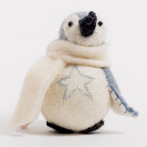 A Craftspring handmade felt penguin ornament with embroidered silver star on their tummy and wearing a white scarf