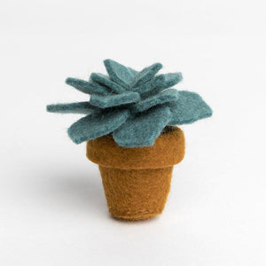 A Craftspring handmade felt desert rose succulent ornament in a tiny felt pot