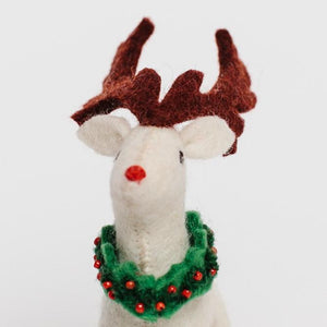 A Craftspring handmade felt rudolph ornament with white fur wearing festive wreath