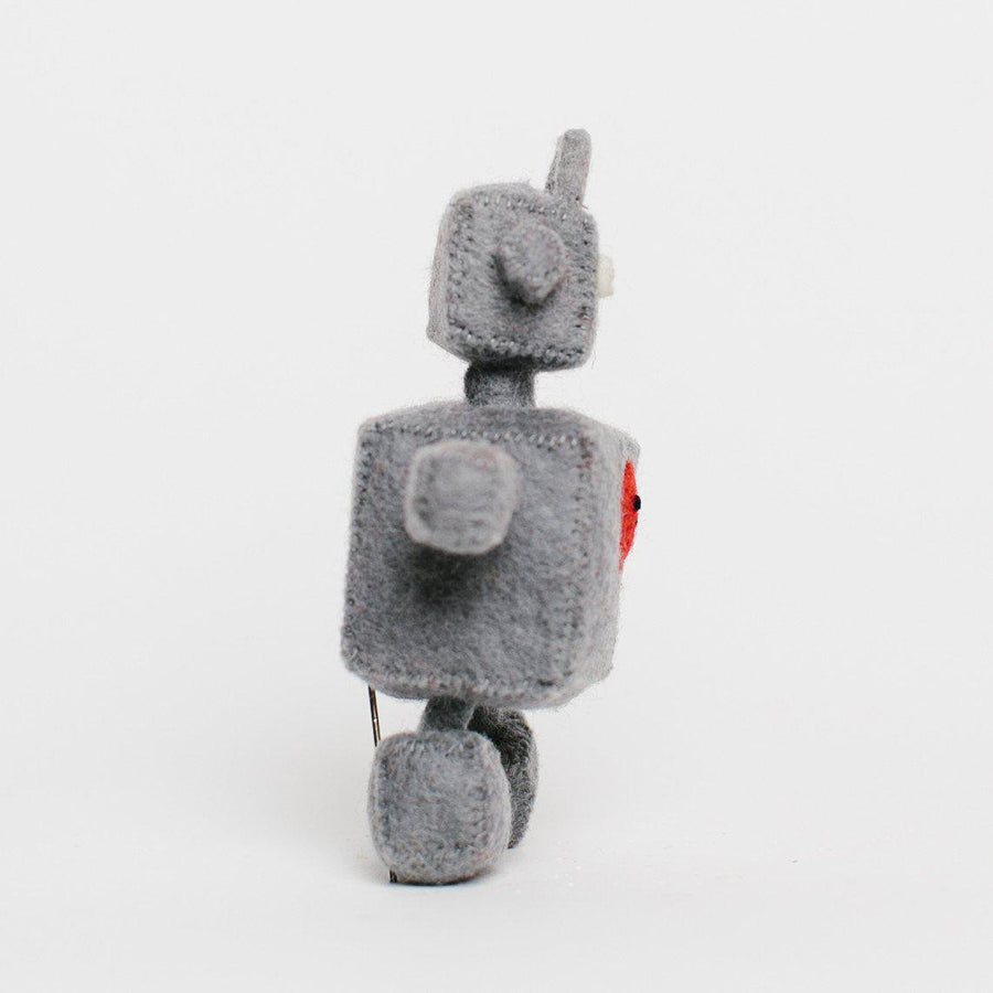 A Craftspring handmade felt robot ornament with a little red heart