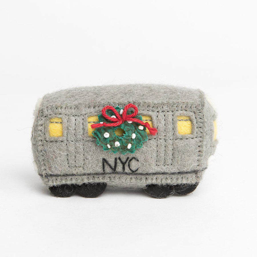A Craftspring handmade felt L train car with a festive wreath on the side