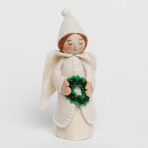 A Craftspring handmade felt holiday tidings angel ornament wearing a white beaded dress and pointy hat and holding a wreath