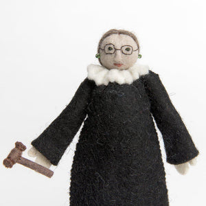 A Craftspring handmade felt RBG ornament with her black robes and gavel