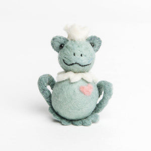 A Craftspring handmade felt frog ornament with a small white crown white ruff and a little pink heart