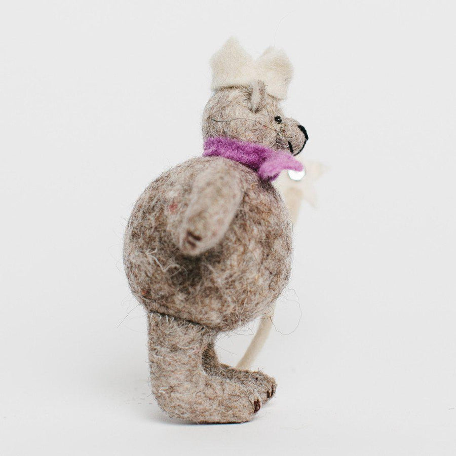 A Craftspring handmade grey felt bear ornament wearing a white crown and holding a white scepter with a star on top