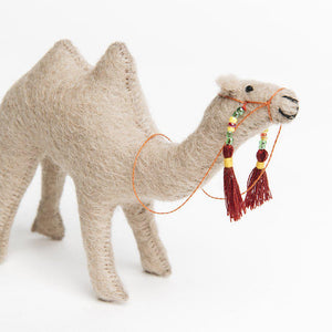 A Craftspring handmade felt camel ornament with a beaded bridal