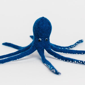 A Craftspring handmade blue felt octopus ornament with beaded suckers and eyes