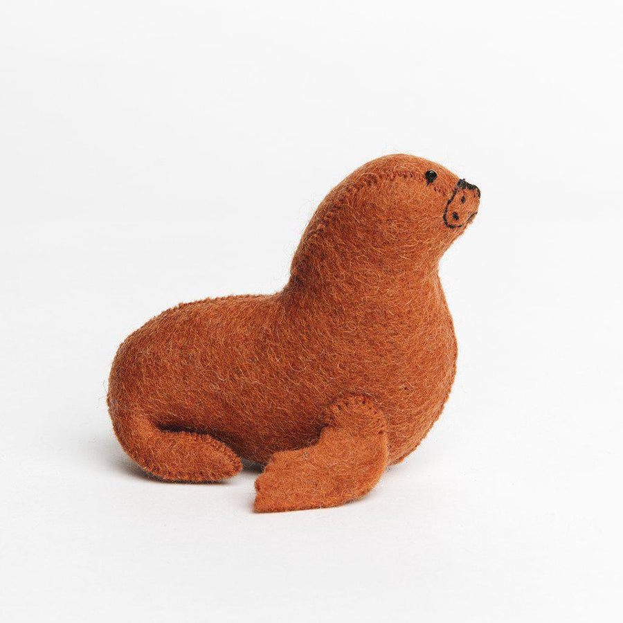 A Craftspring handmade rust felt sea lion ornament