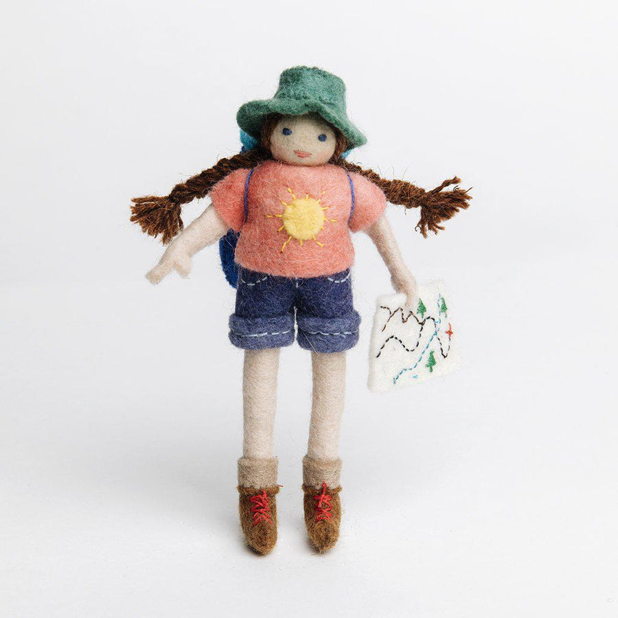 A Craftspring handmade felt Backpacker ornament with long braided pigtails a backpacker backpack and holding a map