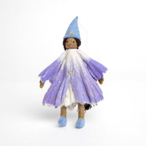 A Craftspring handmade felt princess doll with brown skin wearing a purple gown little blue princess shoes and a pointy blue princess hat with her long black hair in a braid