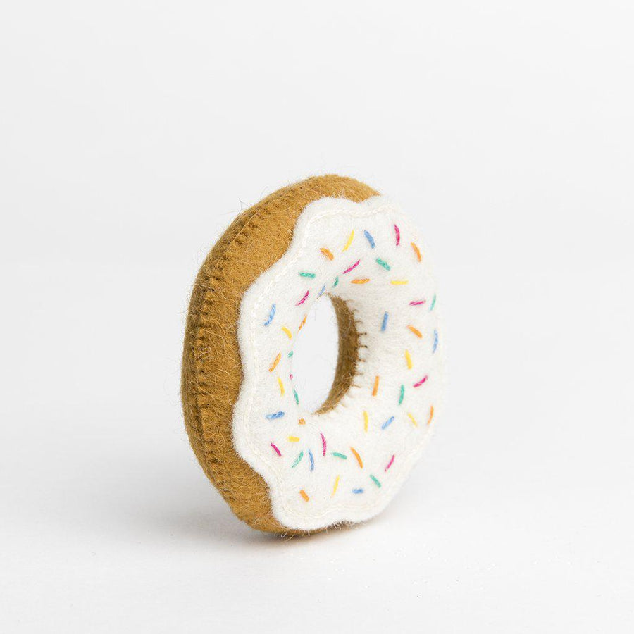 A Craftspring handmade felt glazed donut ornament with rainbow sprinkles