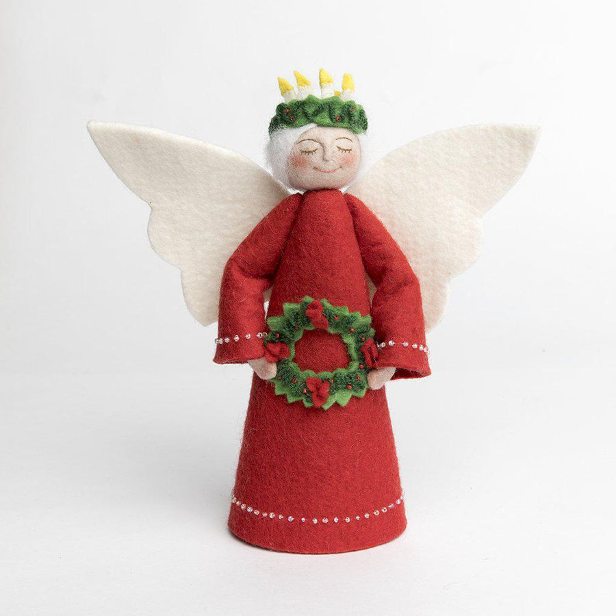 A Craftspring handmade felt Santa Lucia angel tree topper with white hair wearing red gown and holding a festive red and green wreath