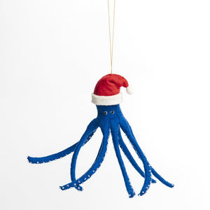 A Craftspring handmade blue felt octopus ornament wearing a santa hat