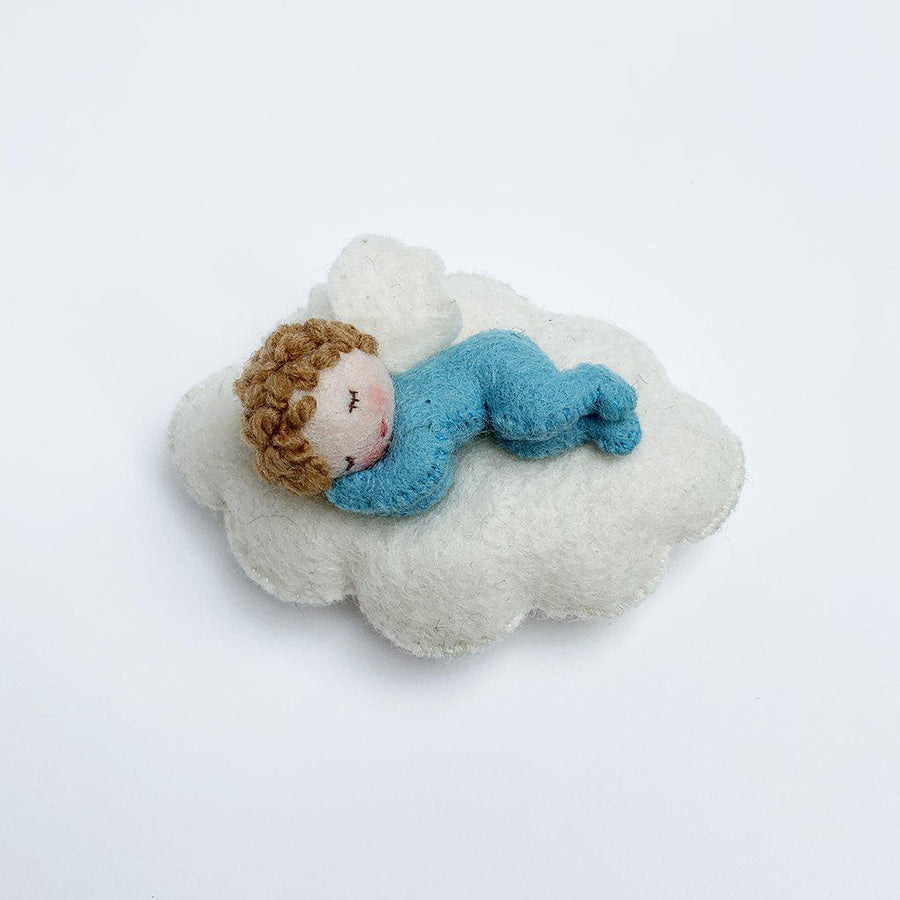 A Craftspring handmade felt baby fairy ornament sleeping on a cloud wearing a blue onesie