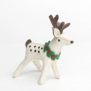 A Craftspring handmade felt white buck reindeer ornament wearing a wreath around his neck