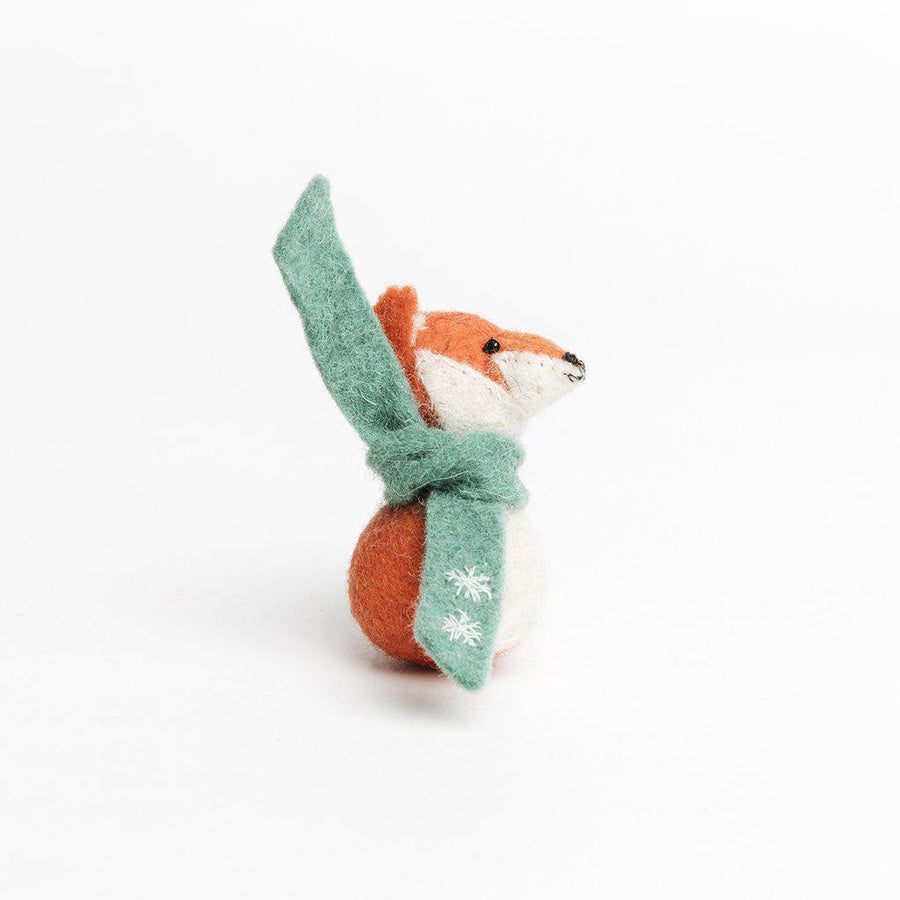A Craftspring handmade felt red fox ornament wearing a green scarf
