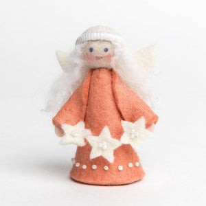 A Craftspring handmade felt starlight angel ornament with long white hair wearing a pink dress and holding a string of white stars