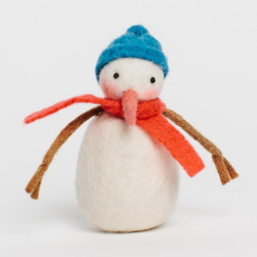 A Craftspring handmade felt Sunny Day Snowman ornament wearing a blue hat and red scarf