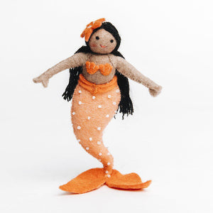 A Craftspring handmade felt sunrise mermaid ornament with long black hair brown skin and an orange beaded tail and seashell top