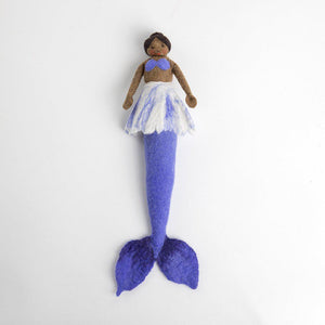 A Craftspring handmade felt mermaid doll with black hair in a bun brown skin and a purple tail and bikini top