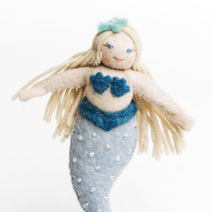 A Craftspring handmade felt mermaid ornament with long blond hair a beaded blue tail and shell top