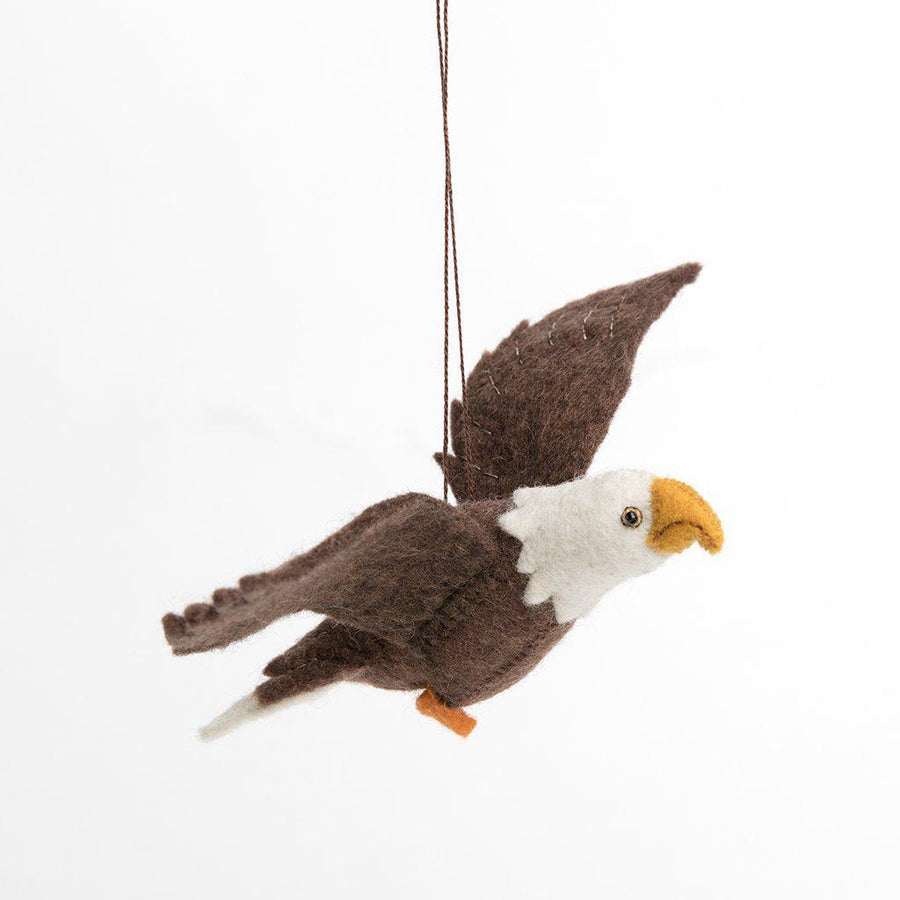 Craftspring handmade eagle in flight ornament with brown feathers, white feather detail on tail and head.