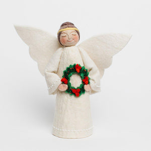 Craftspring handmade tree topper angel with brown hair in a bun, white wings, wearing a white dress, and holding a wreath with red flowers