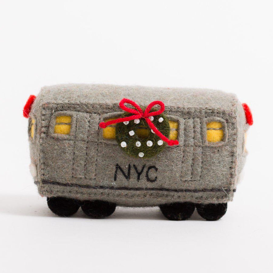A craftspring handmade felt number 2 subway train car with a festive wreath on the side