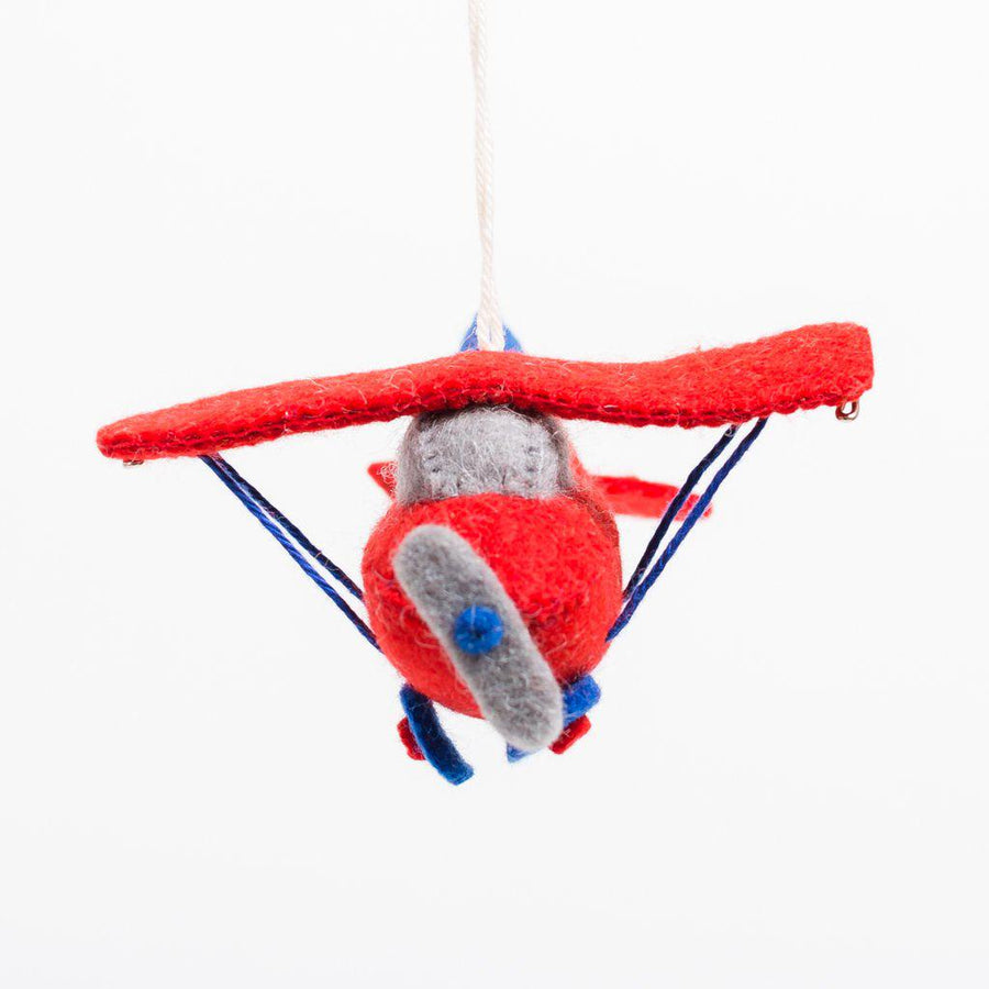 Handmade red plane felt ornament with grey propeller and blue wheels and accents.