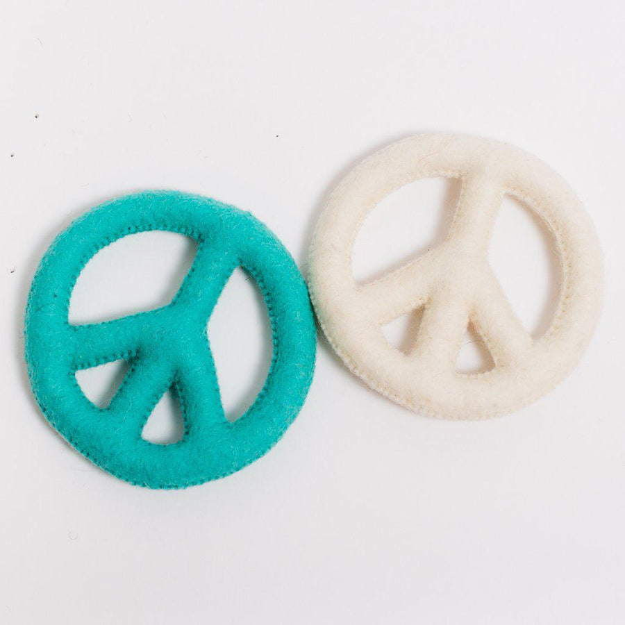 A Craftspring handmade white felt peace sign ornament