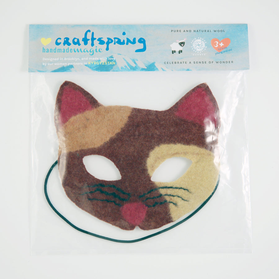 A handmade Craftspring wool felted calico cat mask.