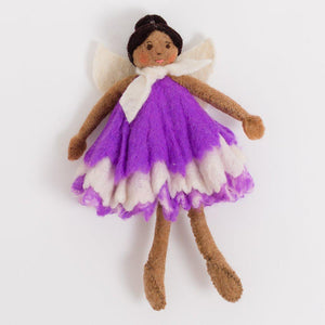A Craftspring handmade felt purple blossom fairy doll with brown skin and black hair in a bun