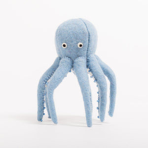 A Craftspring handmade felt octopus ornament in light blue with beaded suction cups and eyes