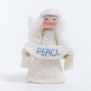 A Craftspring handmade felt angel ornament with a beaded dress white circlet and holding a white sash embroidered with the word peace