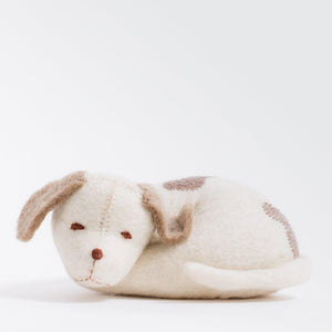 A Craftspring handmade white felt curled up sleeping puppy ornament with beige spots