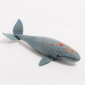 A Craftspring handmade grey felt spyhop whale ornament with embroidered barnacles