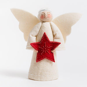 A Craftspring handmade felt angel tree topper wearing a silver circlet in her white hair, a white gown and holding a beaded red star