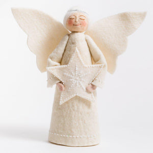 A Craftspring handmade felt angel tree topper wearing a silver circlet in her white hair, a white gown and holding a beaded white star