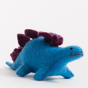 A Craftspring handmade blue felt stegosaurus ornament with purple plates along its back