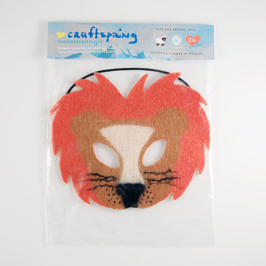 A Craftspring handmade felt lion mask with a pink mane and white nose