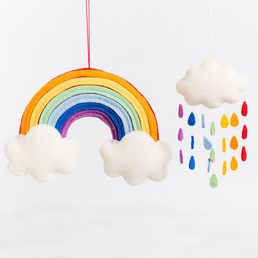 A Craftspring handmade felt rainbow ornament with two little clouds