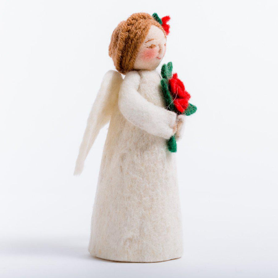 A Craftspring handmade felt angel ornament wearing white robes holding a bouquet of poinsettias with her hair up in braids