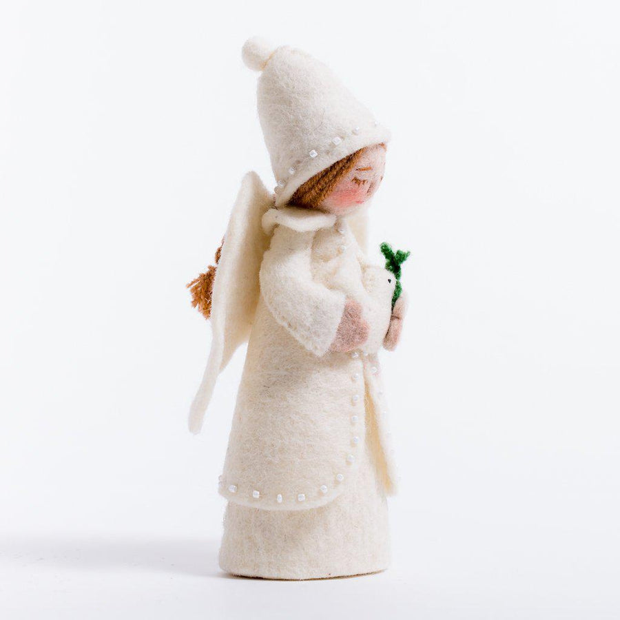 A Craftspring handmade felt holiday tidings angel ornament wearing a white beaded dress and pointy hat and holding a dove